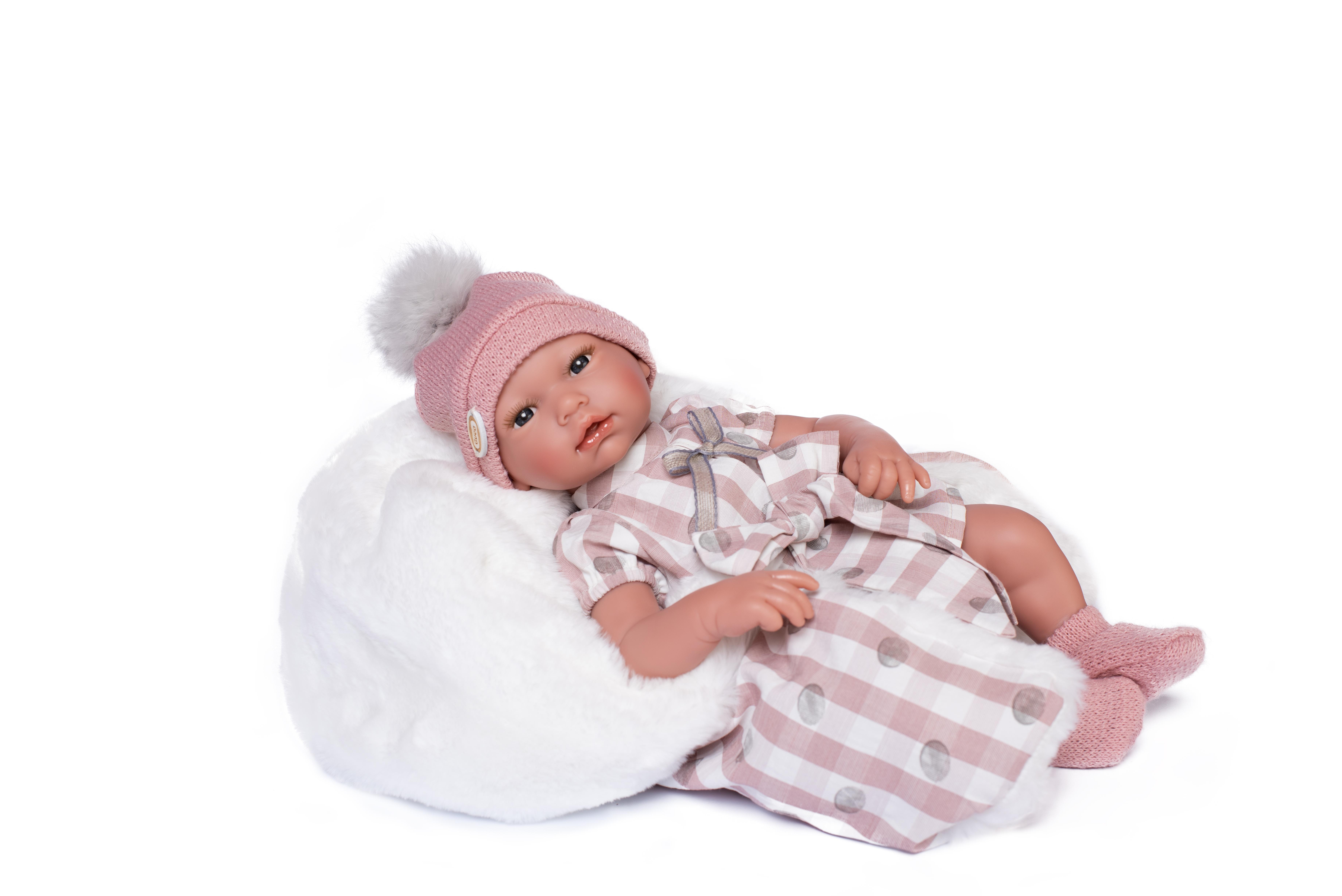 Lara Bebé con ropa rosa con lunares