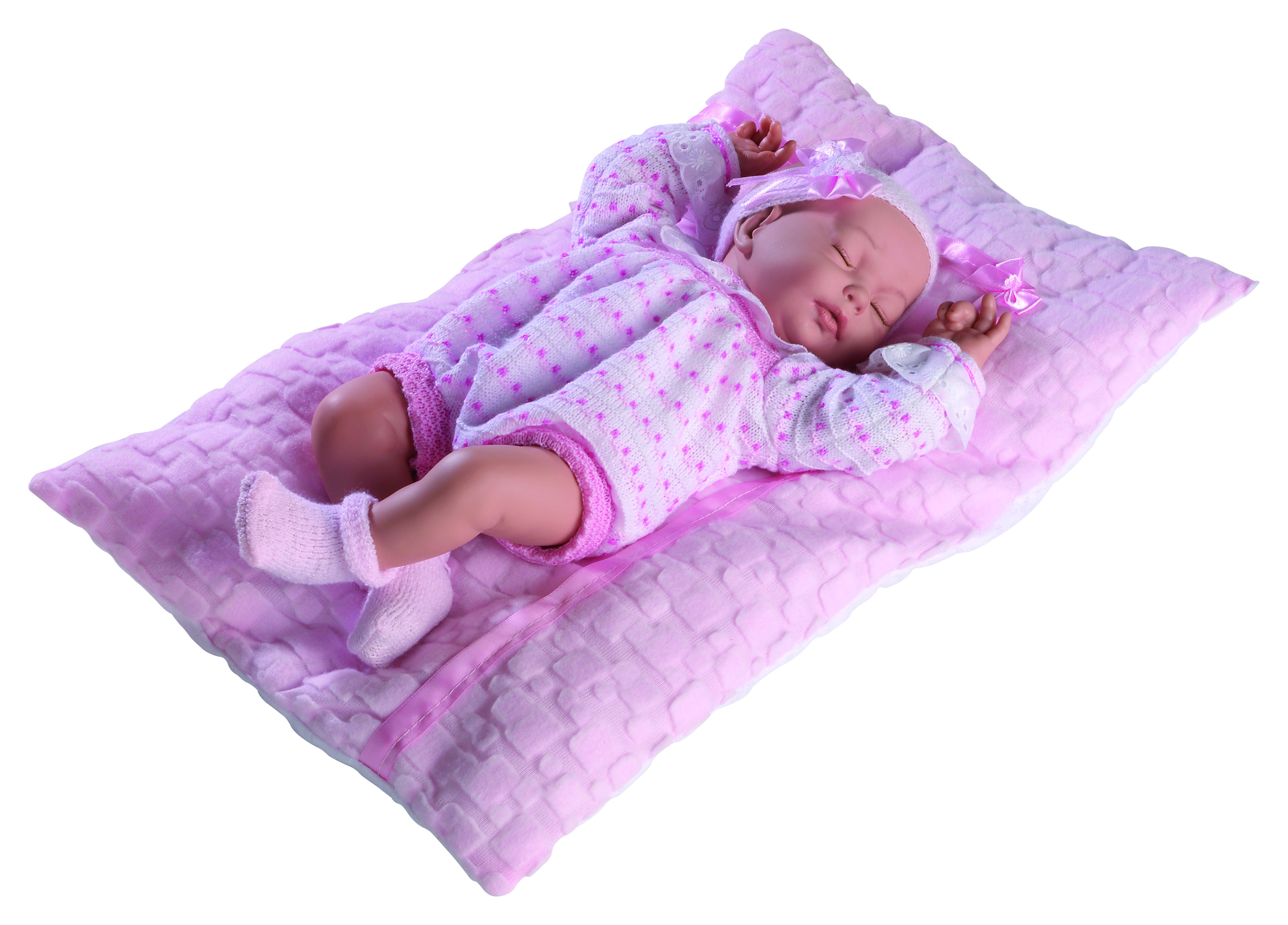 Cris Bebé con ropita rosada y cojín blanco