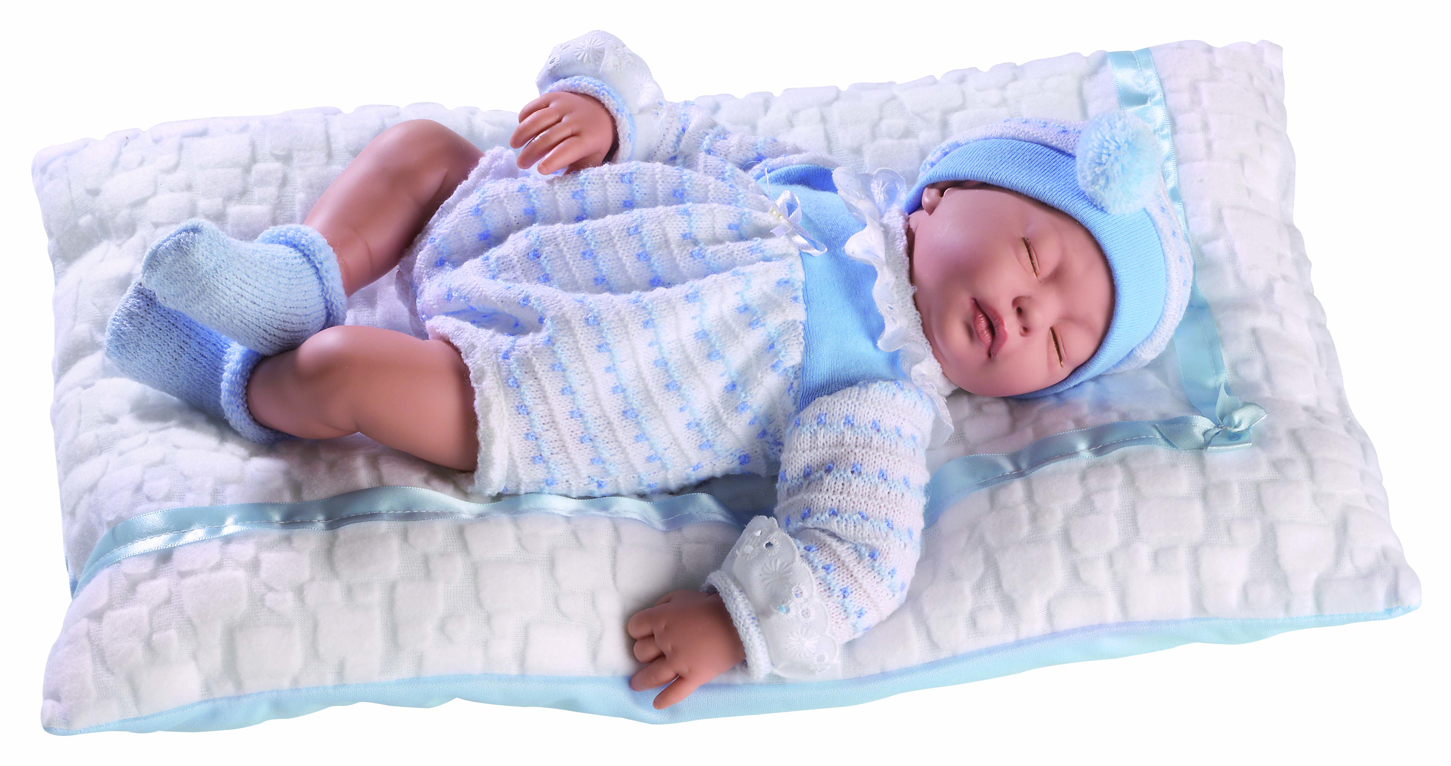 Cris Bebé con ropita celeste y cojín blanco